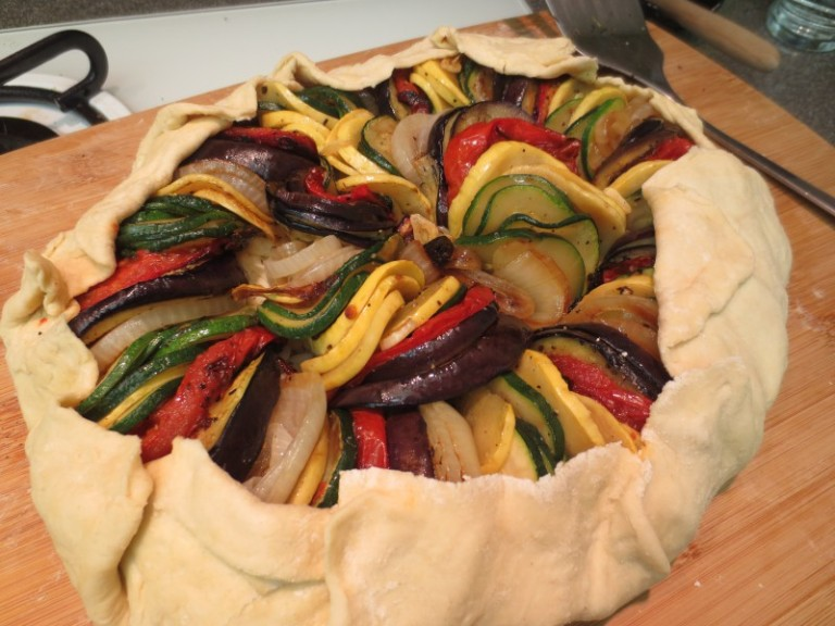 Before baking! Ratatouille Galette. Don't make the mistake I did. Assemble directly on a parchment lined baking sheet NOT a cutting board.